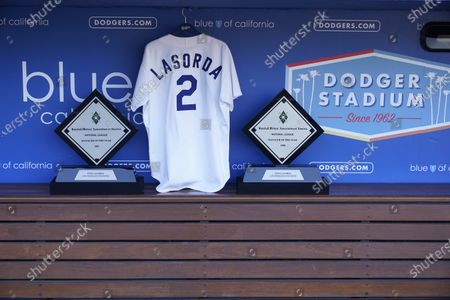 Tommy Lasorda's jersey is placed in the Dodgers dugout at Dodger Stadium, in Los Angeles. Tommy Lasorda, the fiery Hall of Fame manager who guided the Los Angeles Dodgers to two World Series titles and later became an ambassador for the sport he loved during his 71 years with the franchise, has died. He was 93