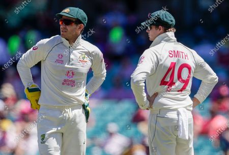 Australian captain Tim Paine, left, talks with teammate Steve Smith during play on day three of the third cricket test between India and Australia at the Sydney Cricket Ground, Sydney, Australia