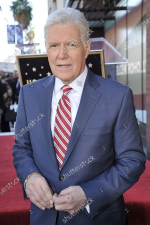 """Alex Trebek, host of """"Jeopardy!"""" attends a ceremony honoring the show's executive producer Harry Friedman with a star on the Hollywood Walk of Fame on Nov. 1, 2019, in Los Angeles. More than two months after Trebek's death, fans of """"Jeopardy!"""" finally got the chance to say goodbye. A video tribute to the host opened the, episode of the quiz show, the final one that Trebek taped before pancreatic cancer claimed his life on Nov. 8"""