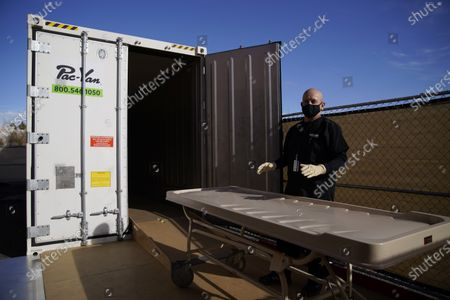 Michael Murphy, a consultant serving as interim Clark County coroner, gives a tour of a refrigerated trailer at the coroner's office, in Las Vegas. The trailer is currently unused but is in place in case of a surge in coronavirus deaths
