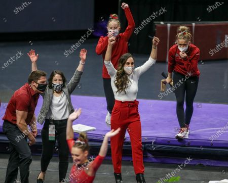 Arkansas Head Coach Jordyn Wieber and some of her team react after a great performance on the balance beam during NCAA Gymnastics action between the Arkansas Razorbacks and the LSU Tigers at the Pete Maravich Assembly Center in Baton Rouge, LA