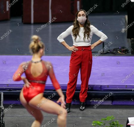 Arkansas Head Coach Jordyn Wieber watches as one of her girls competes on the balance beam during NCAA Gymnastics action between the Arkansas Razorbacks and the LSU Tigers at the Pete Maravich Assembly Center in Baton Rouge, LA