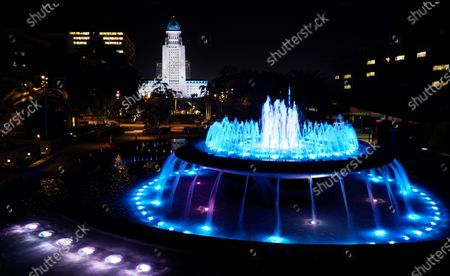 """Los Angeles City Hall and a nearby fountain are lit in """"Dodger blue"""" in tribute to the late longtime Los Angeles Dodgers baseball manager Tommy Lasorda, in Los Angeles. Lasorda, the fiery Hall of Fame manager who guided the Dodgers to two World Series titles and later became an ambassador for the sport he loved during his 71 years with the franchise, has died. He was 93"""
