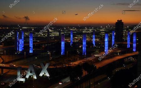 """Pylons at Los Angeles International Airport are illuminated in """"Dodger Blue"""" in tribute to the late longtime Los Angeles Dodgers manager Tommy Lasorda, in Los Angeles. Lasorda died of a heart attack Thursday night at his home in Fullerton, Calif. He was 93"""