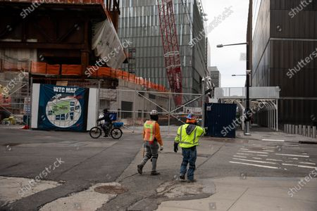 Stock Photo of Construction workers walk in front of the Ronald O. Perelman Performing Arts Center at the World Trade Center construction site, in New York, United States, Jan. 8, 2021. U.S. employers slashed 140,000 jobs in December, the first monthly decline since April 2020, as the recent COVID-19 spikes disrupted labor market recovery, the Labor Department reported Friday.  The unemployment rate, which has been trending down over the past seven months, remained unchanged at 6.7 percent, according to the monthly employment report.