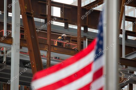 A construction worker works at the Ronald O. Perelman Performing Arts Center at the World Trade Center construction site, in New York, United States, Jan. 8, 2021. U.S. employers slashed 140,000 jobs in December, the first monthly decline since April 2020, as the recent COVID-19 spikes disrupted labor market recovery, the Labor Department reported Friday.  The unemployment rate, which has been trending down over the past seven months, remained unchanged at 6.7 percent, according to the monthly employment report.