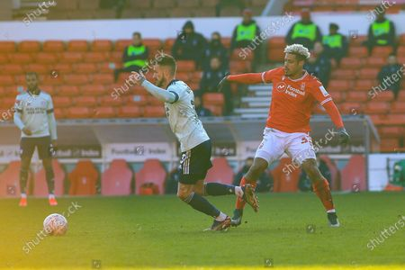 Lyle Taylor (33) of Nottingham Forest makes a challenge on Joe Bennett (3) of Cardiff City during the FA Cup match between Nottingham Forest and Cardiff City at the City Ground, Nottingham