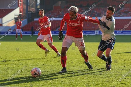 Lyle Taylor (33) of Nottingham Forest holds off a challenge from Joe Bennett (3) of Cardiff City during the FA Cup match between Nottingham Forest and Cardiff City at the City Ground, Nottingham