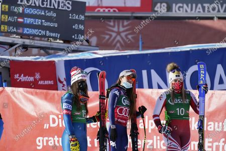 From left, third placed United States' Breezy Johnson, first placed Italy's Sofia Goggia and second placed, Austria's Tamara Tippler celebrate at the end of an alpine ski, women's World Cup downhill in St. Anton, Austria