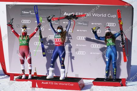 From left, second placed Austria's Tamara Tippler, first placed Italy's Sofia Goggia celebrate and third placed United States' Breezy Johnson celebrate at the end of an alpine ski, women's World Cup downhill in St. Anton, Austria