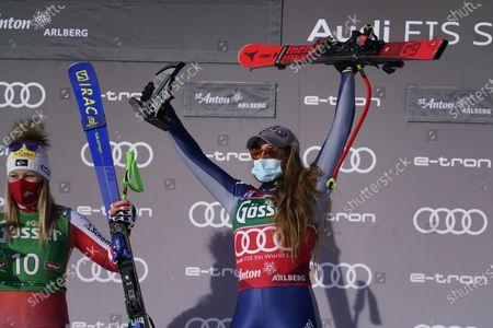 From left, second placed Austria's Tamara Tippler, and first placed Italy's Sofia Goggia celebrate celebrate at the end of an alpine ski, women's World Cup downhill in St. Anton, Austria