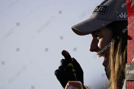 Italy's Sofia Goggia smiles at the finish area during an alpine ski, women's World Cup downhill in St. Anton, Austria