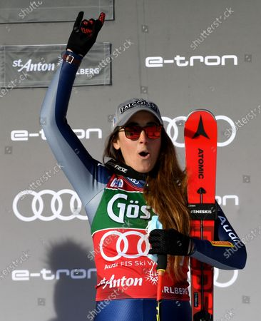 The first placed Sofia Goggia of Italy celebrates on the podium for the Women's Downhill race at the FIS Alpine Skiing World Cup in St. Anton am Arlberg, Austria, 09 January 2021.