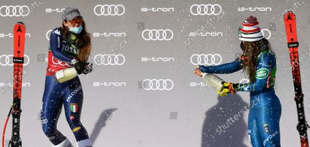 The first placed Sofia Goggia (L) of Italy and third placed Breezy Johnson of the US celebrate on the podium for the Women's Downhill race at the FIS Alpine Skiing World Cup in St. Anton am Arlberg, Austria, 09 January 2021.