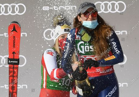 Second placed Tamara Tippler (L) of Austria and  first placed Sofia Goggia of Italy celebrate on the podium for the Women's Downhill race at the FIS Alpine Skiing World Cup in St. Anton am Arlberg, Austria, 09 January 2021.