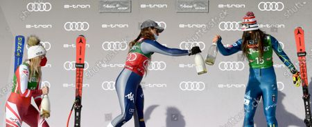 (L-R) Second placed Tamara Tippler of Austria, first placed Sofia Goggia of Italy and third placed Breezy Johnson of the US celebrate on the podium for the Women's Downhill race at the FIS Alpine Skiing World Cup in St. Anton am Arlberg, Austria, 09 January 2021.