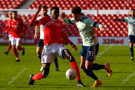 Cafu of Nottingham Forest sticks a foot out to stop a run by Josh Murphy of Cardiff City