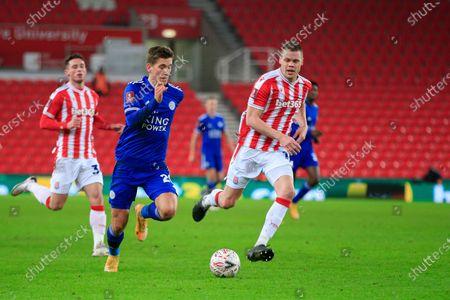 Dennis Praet #26 of Leicester City runs past Ryan Shawcross #17 of Stoke City