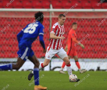 Ryan Shawcross #17 of Stoke City runs with the ball
