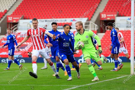 Kasper Schmeichel #1 of Leicester City collects the ball from a Stoke attack