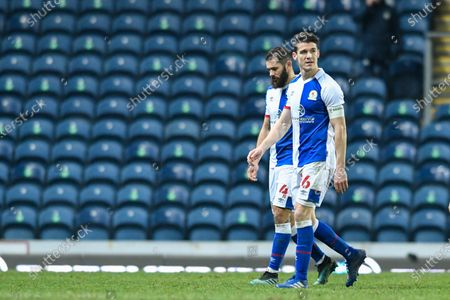 Darragh Lenihan #26 and Bradley Johnson #4 of Blackburn Rovers leave the pitch looking dejected after seeing their side knocked out of the FA Cup by Doncaster Rovers