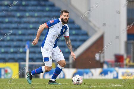 Bradley Johnson #4 of Blackburn Rovers runs forward with the ball