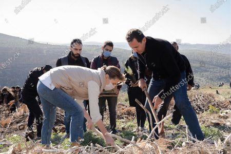 Syrian President Bashar al-Assad and his wife Asma during the afforestation of Harsh al-Tufaha (Apple Forest) area in al-Drekish countryside in western Syria.