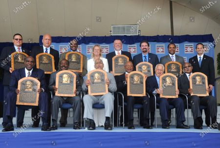 Stock Picture of New York, NY-July 28: Hall of Fame members (L-R) Andre Dawson, Joe Morgan, Orlando Cepeda, Ozzie Smith, Tommy Lasorda, Billy Williams, (top Row) Carlton Fisk, Cal Ripken, Jim rice, Jane Clark, Bert Blyleven, Wade Boggs, Barry Larkin and Jeff Idelson attend the National Baseball Hall of Fame induction ceremony on July 28, 2013 in Cooperstown, New York.