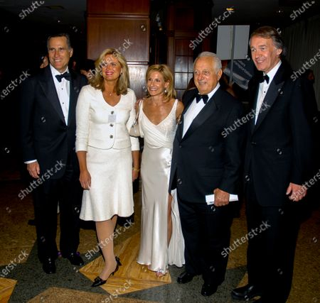 Governor Mitt Romney his wife Ann with Doctor Susan Blumenthal, Tommy Lasorda and Senator Ed Markey (D-Massachusetts) pose while arriving at the annual White House correspondents dinner at the Washington Hilton Hotel