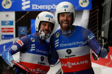 Chris Mazdzer (R) and Jayson Terdiman of USA react in the finish area during the men's double competition at the Luge World Cup event in Sigulda, Latvia, 09 January 2021.