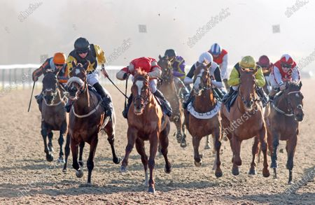TOROCHICA (centre, Charles Bishop) beats OSLO (left) in The Betway Casino Handicap Lingfield