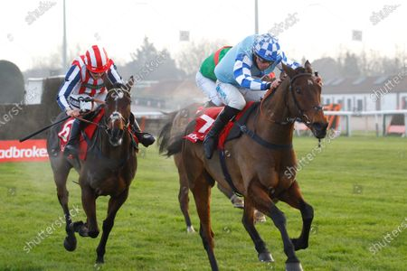 Double Shuffle and James Bowen [right] wins the Ladbrokes Committed To Safer Gambling Handicap Chase at Kempton from Ami Desbois and Lilly Pinchin who nearly falls.