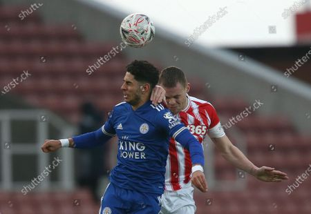 Stoke City's Ryan Shawcross battles with Leicester City's Ayote Perez