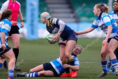 Heather Fisher of Worcester Warriors Women is tackled by George Roberts of DMP Durham Sharks