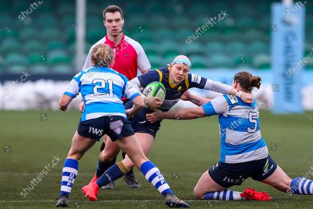 Heather Fisher of Worcester Warriors Women is tackled by Amy Orrow and George Roberts of DMP Durham Sharks