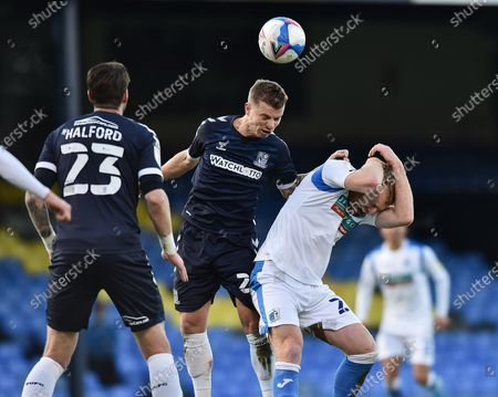 Southend United defender Jason Demetriou heads the ball during the EFL Sky Bet League 2 match between Southend United and Barrow at Roots Hall, Southend