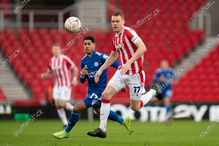 Ryan Shawcross of Stoke centre right fights for the ball against Leicester's Ayoze Perez
