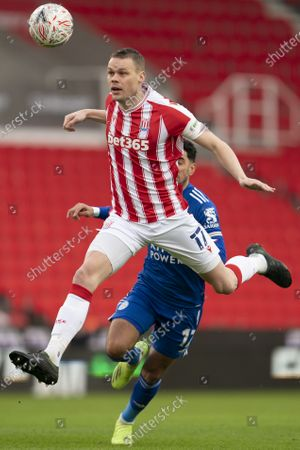 Ryan Shawcross of Stoke centre left fights for the ball against Leicester's Ayoze Perez