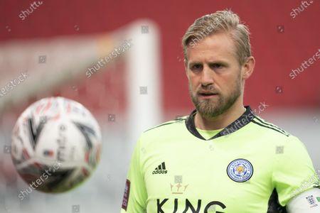 Leicester goalkeeper Kasper Schmeichel retrieves a ball