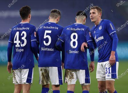 (L-R) Matthew Hoppe, Matija Nastasic, Suat Serdar and Timo Becker of FC Schalke 04 stand in a wall during the Bundesliga match between FC Schalke 04 and TSG Hoffenheim at Veltins-Arena in Gelsenkirchen, Germany, 09 January 2021.