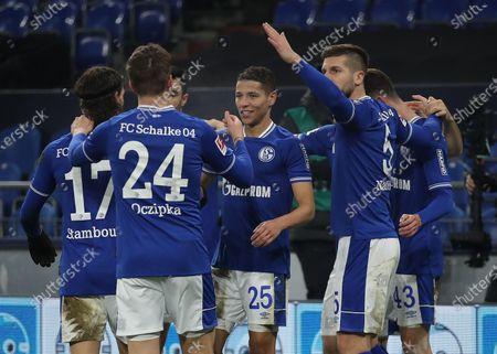 Amine Harit (C) of FC Schalke 04 celebrates with Matija Nastasic (2-R) after scoring their team's fourth goal during the Bundesliga match between FC Schalke 04 and TSG Hoffenheim at Veltins-Arena in Gelsenkirchen, Germany, 09 January 2021.