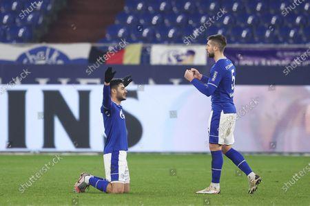 Ozan Kabak (L) and Matija Nastasic of FC Schalke 04 celebrate after winning the Bundesliga match between FC Schalke 04 and TSG Hoffenheim at Veltins-Arena in Gelsenkirchen, Germany, 09 January 2021.