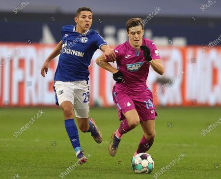 Christoph Baumgartner (R) of TSG 1899 Hoffenheim is challenged by Amine Harit of FC Schalke 04 during the Bundesliga match between FC Schalke 04 and TSG Hoffenheim at Veltins-Arena in Gelsenkirchen, Germany, 09 January 2021.
