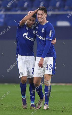Matthew Hoppe (R) of FC Schalke 04 celebrates with Amine Harit after scoring their team's first goal during the Bundesliga match between FC Schalke 04 and TSG Hoffenheim at Veltins-Arena in Gelsenkirchen, Germany, 09 January 2021.