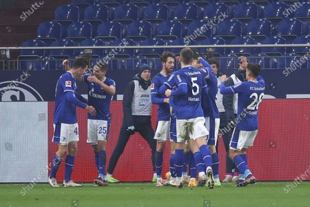Matthew Hoppe (L) of FC Schalke 04 celebrates with Amine Harit (2-L) after scoring their team's first goal during the Bundesliga match between FC Schalke 04 and TSG Hoffenheim at Veltins-Arena in Gelsenkirchen, Germany, 09 January 2021.