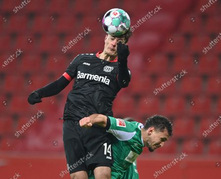 Leverkusen's Patrik Schick (L) in action against Bremen's Milos Veljkovic (R) during the German Bundesliga soccer match between Bayer 04 Leverkusen and SV Werder Bremen in Leverkusen, Germany, 09 January 2021.