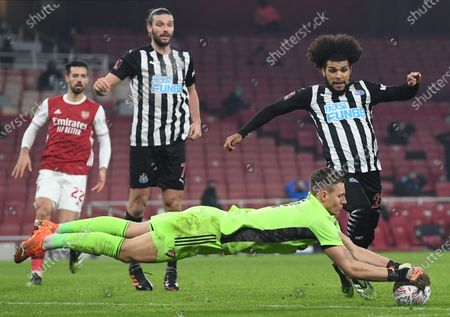 Stock Photo of Goalkeeper Bernd Leno (down) of Arsenal in action against DeAndre Yedlin (R) of Newcastle during the English FA Cup third round soccer match between Arsenal and Newcastle United in London, Britain, 09 January 2021.