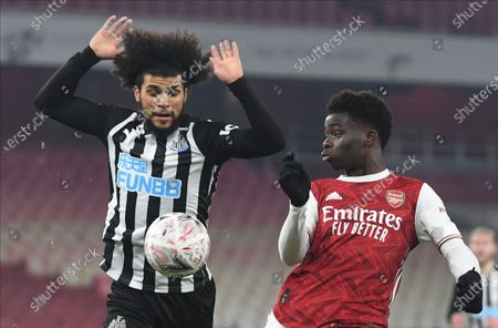 Stock Image of Bukayo Saka (R) of Arsenal in action against DeAndre Yedlin (L) of Newcastle during the English FA Cup third round soccer match between Arsenal and Newcastle United in London, Britain, 09 January 2021.