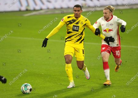 Stock Picture of Dortmund's Manuel Akanji, left, and Leipzig's Emil Forsberg challenge for the ball during the German Bundesliga soccer match between RB Leipzig and Borussia Dortmund in Leipzig, Germany