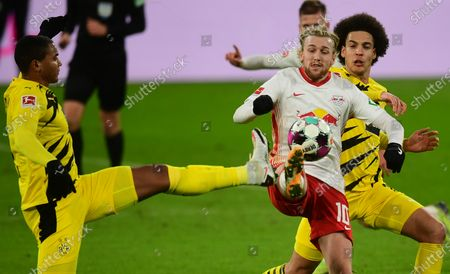 Dortmund's Manuel Akanji (L) and Axel Witsel (R) in action against Leipzig's Emil Forsberg (C) during the German Bundesliga soccer match between RB Leipzig and Borussia Dortmund in Leipzig, Germany, 09 January 2021.